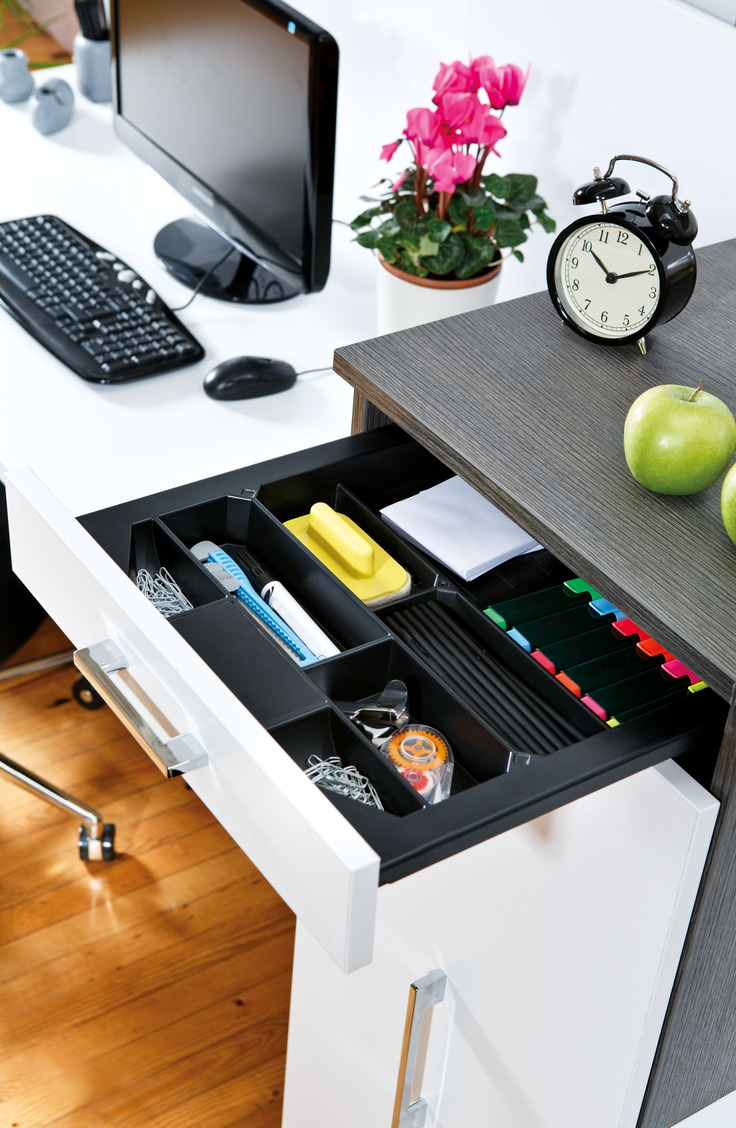 A silverware drawer organizer works perfectly for your desk. Get the most out of your tiny dorm room space with 14 items that promise better dorm room organization.