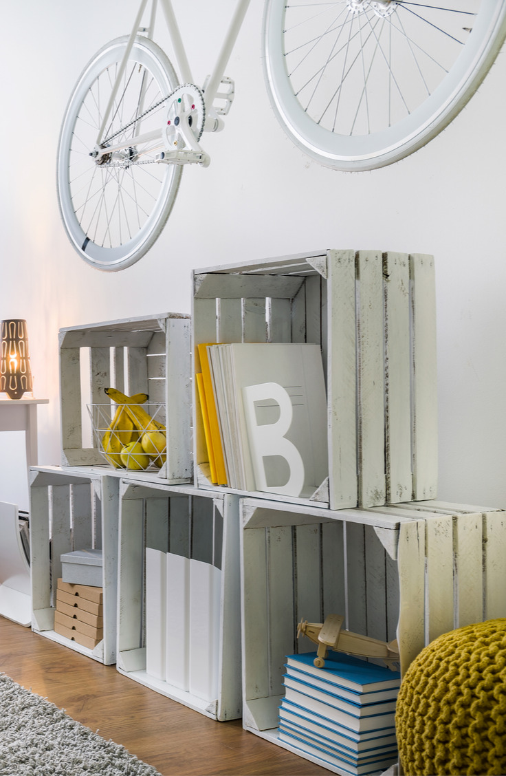 Wooden crates are perfect for dorm rooms. Get the most out of your tiny dorm room space with 14 items that promise better dorm room organization.