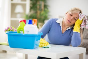 Woman Stressed over dirty rooms. Just waiting for OxiClean Hacks.