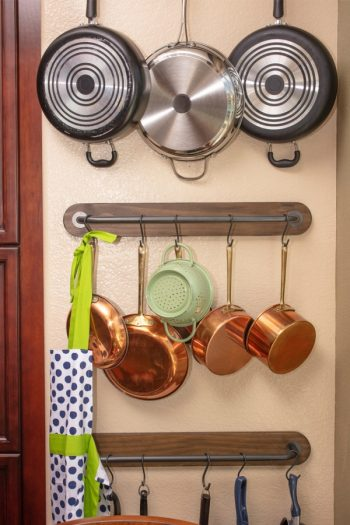 It can be a pain trying to figure out how to store pots and pans. These 4 tips on how to store pots and pans will change your life. Your kitchen will be more organized than ever!