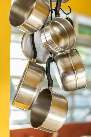 If you're looking for a better way to store pots and pans, you've come to the right place! Check out these tips on how to store pots and pans and enjoy your organized kitchen!