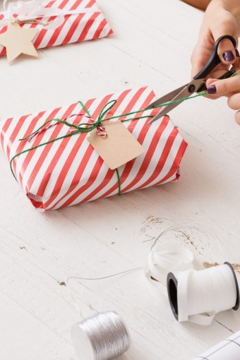Wrapping presents for Christmas can be so messy. If you want to stay more organized this year, try creating a Christmas wrapping station. It will change your life.