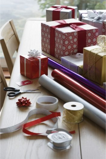 Do you hate how messy wrapping paper is? Try creating a Christmas wrapping station. Everything will stay so neat and organized.