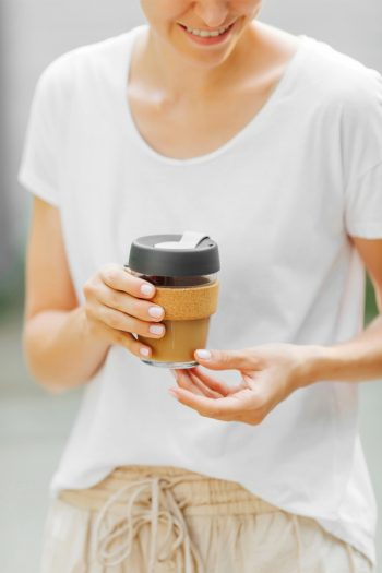 A low-waste lifestyle is just like it sounds--low-waste. It all centers on the environment. Try purchasing some reusable coffee cups. Think about how much trash you're saving!
