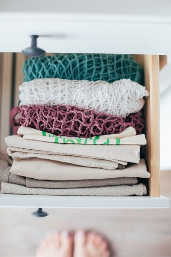 It's time to organize your kitchen with Marie Kondo's kitchen organization tips, because these are tips everyone can use! Make sure you fold your kitchen linens and place them in an upright position. That way you can see what you have and grab what you need.