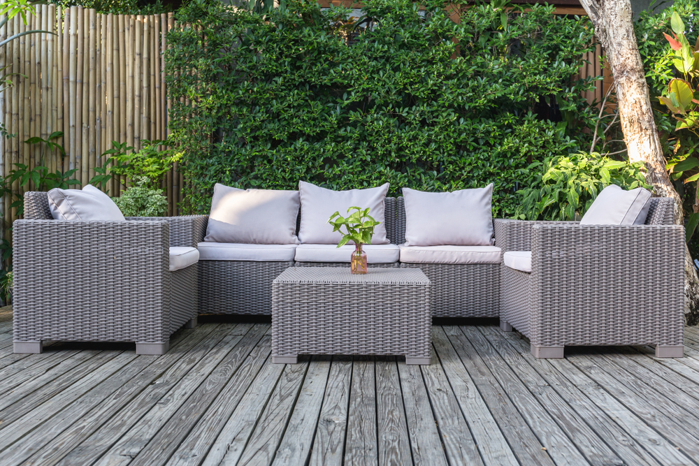 Beautiful patio furniture on a wooden deck.