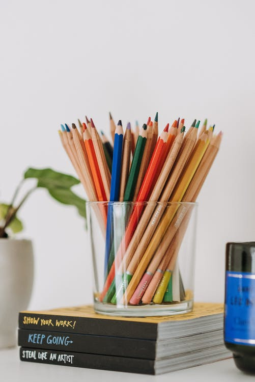 Colorful pencils in a glass jar - kids' room organization